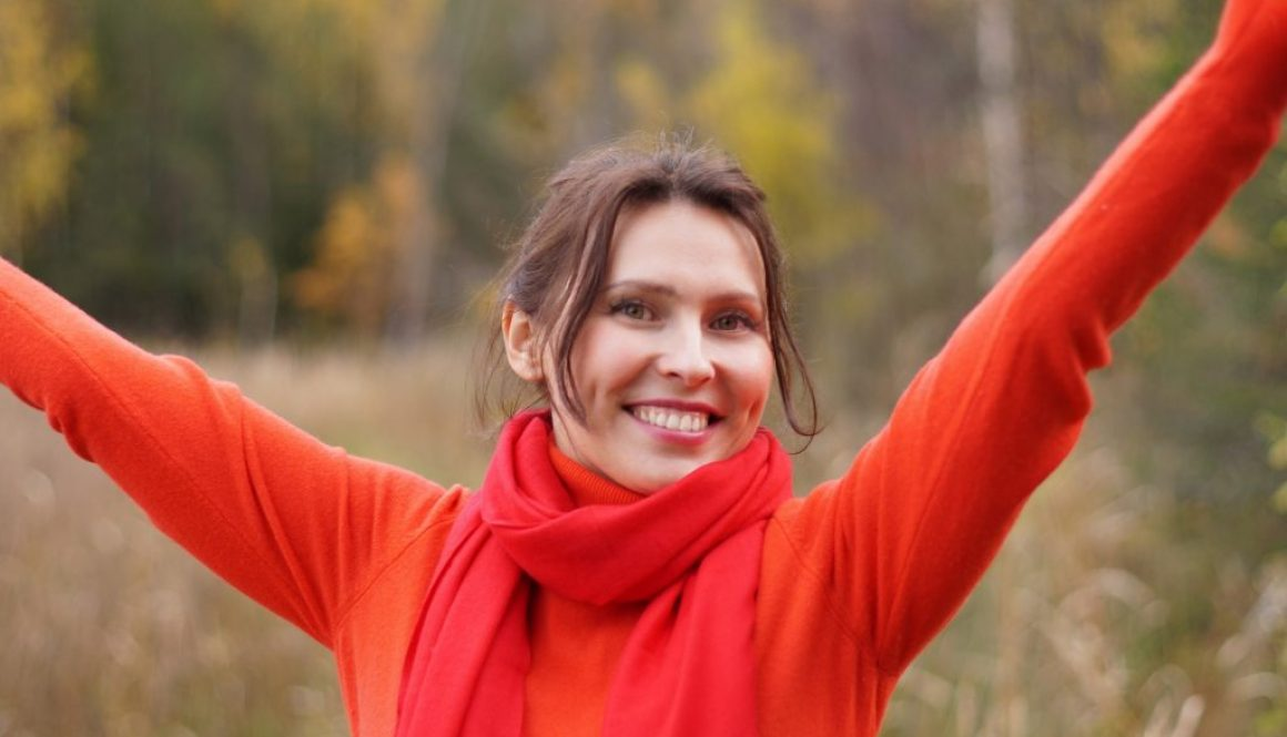 woman celebrating with hands up dating eguide